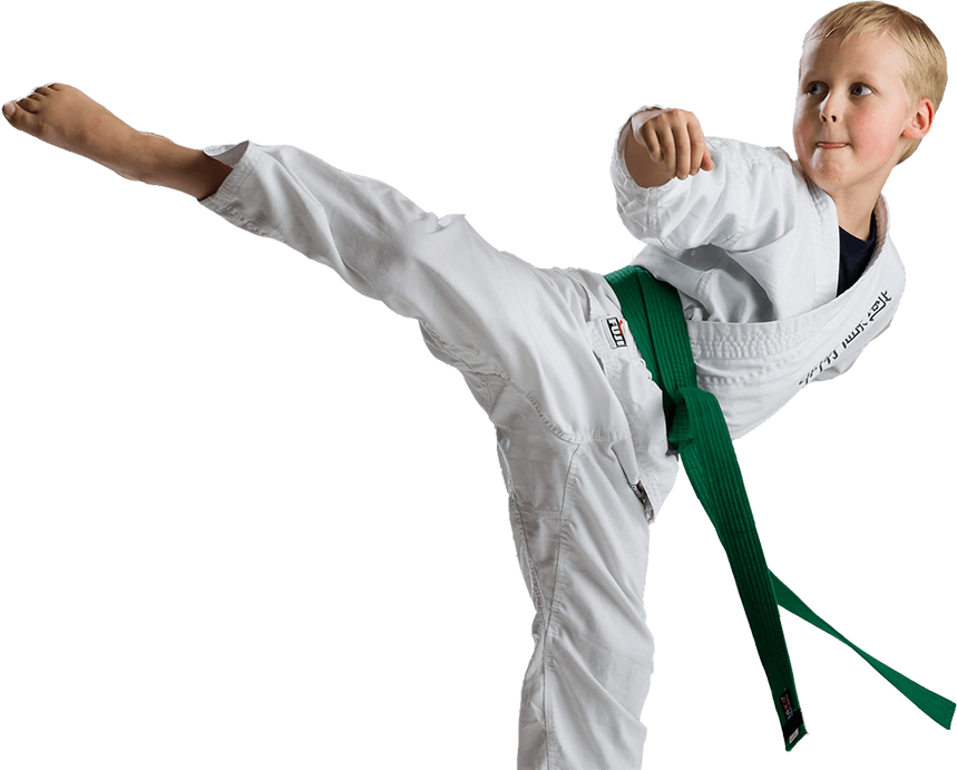 Kid practicing Karate kick