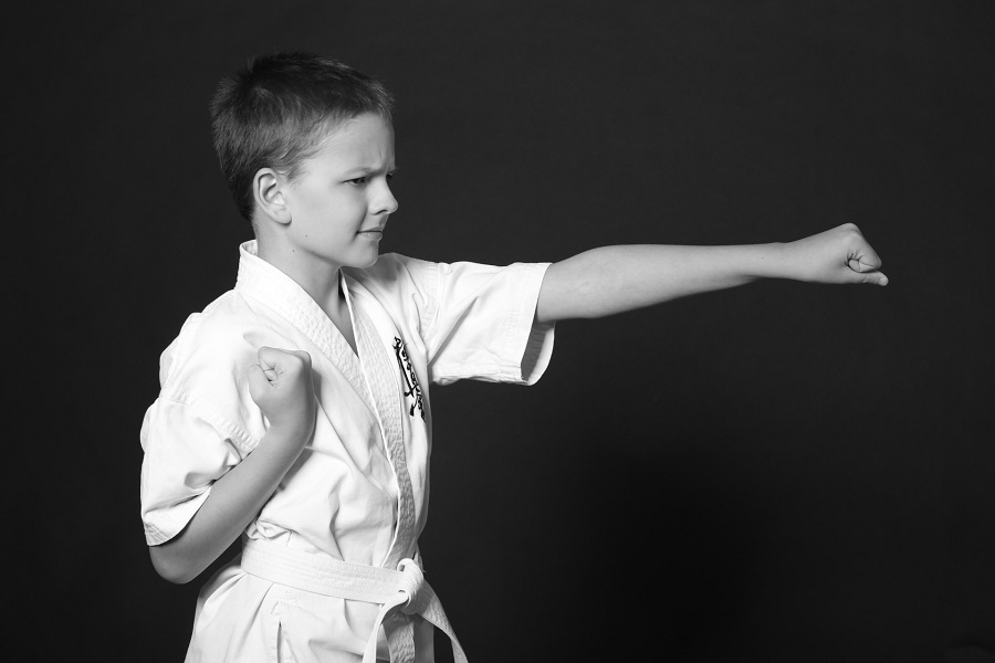 Karate student practicing a front punch