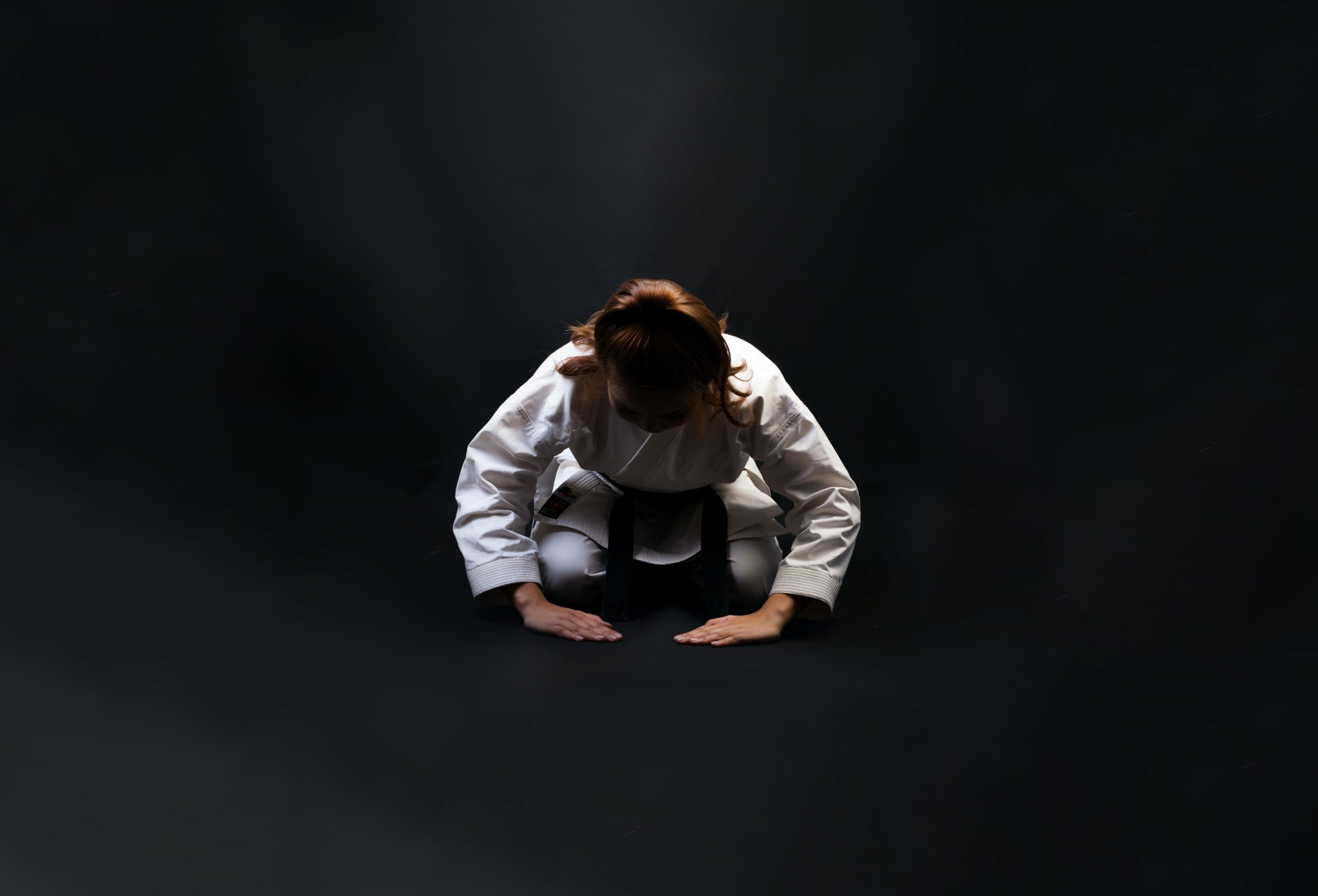 woman in karate uniform bowing