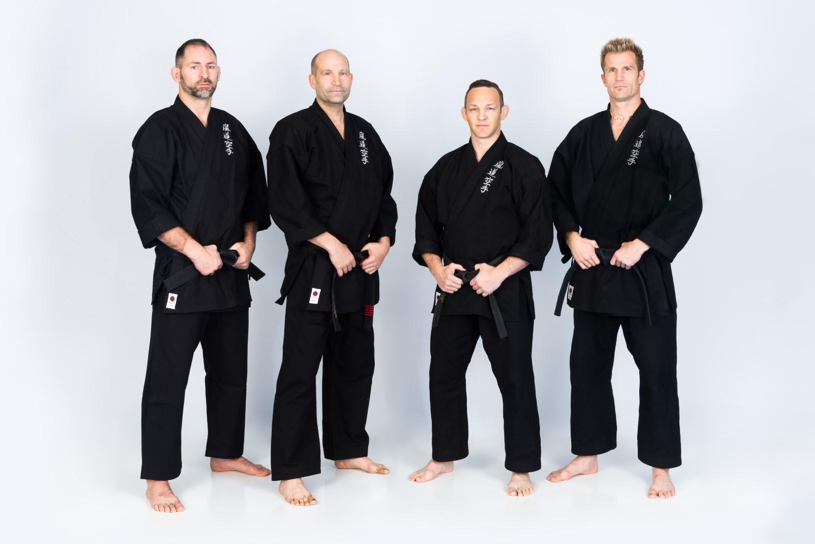 4 Head Instructors Posing in Black Uniforms